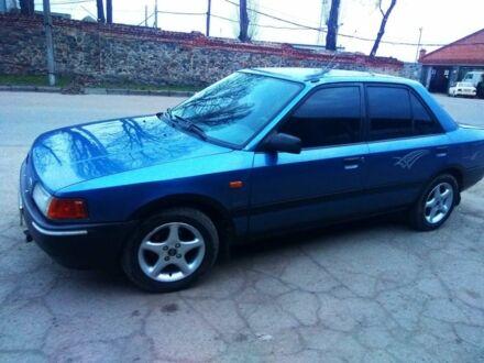 Синій Мазда 323, об'ємом двигуна 1.4 л та пробігом 320 тис. км за 1750 $, фото 1 на Automoto.ua