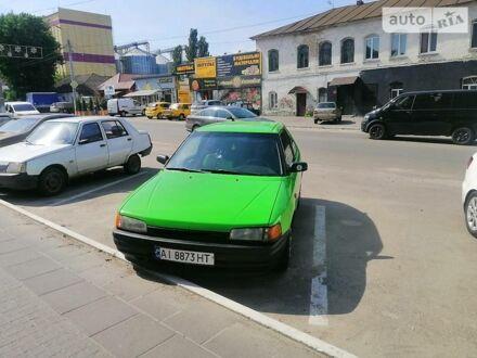 Зеленый Мазда 323, объемом двигателя 1.3 л и пробегом 340 тыс. км за 1500 $, фото 1 на Automoto.ua
