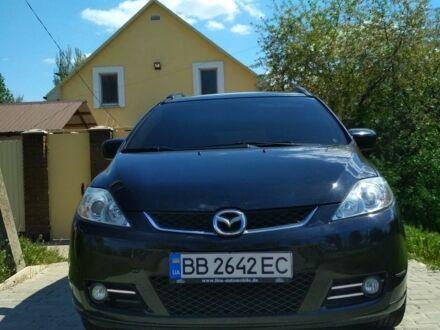Черный Мазда 5, объемом двигателя 1.8 л и пробегом 230 тыс. км за 6800 $, фото 1 на Automoto.ua