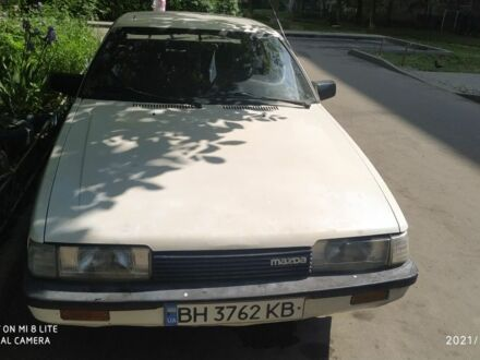Белый Мазда 626, объемом двигателя 2 л и пробегом 400 тыс. км за 1250 $, фото 1 на Automoto.ua