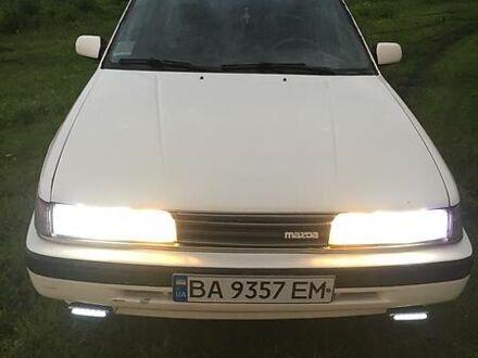 Белый Мазда 626, объемом двигателя 2 л и пробегом 200 тыс. км за 1150 $, фото 1 на Automoto.ua