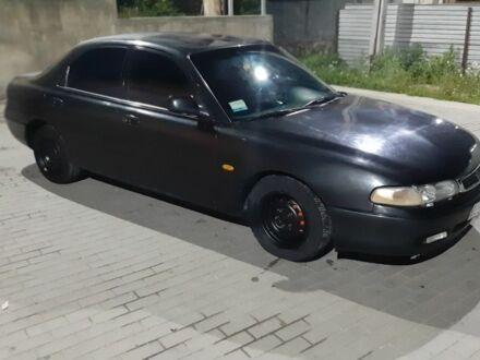 Черный Мазда 626, объемом двигателя 2 л и пробегом 200 тыс. км за 2000 $, фото 1 на Automoto.ua