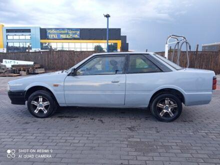 Серый Мазда 626, объемом двигателя 1.6 л и пробегом 150 тыс. км за 950 $, фото 1 на Automoto.ua