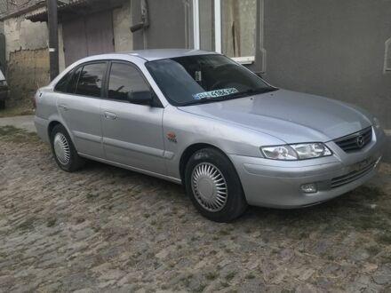 Серый Мазда 626, объемом двигателя 1.8 л и пробегом 350 тыс. км за 3500 $, фото 1 на Automoto.ua