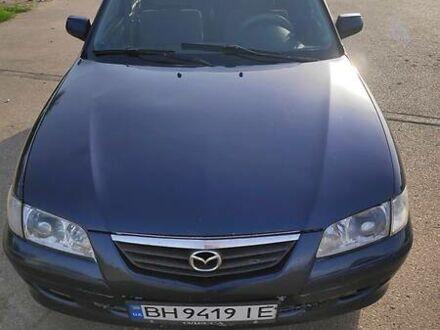 Синий Мазда 626, объемом двигателя 1.8 л и пробегом 258 тыс. км за 3700 $, фото 1 на Automoto.ua