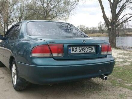 Зеленый Мазда 626, объемом двигателя 2 л и пробегом 111 тыс. км за 3450 $, фото 1 на Automoto.ua