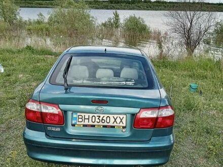 Зеленый Мазда 626, объемом двигателя 2 л и пробегом 240 тыс. км за 4100 $, фото 1 на Automoto.ua