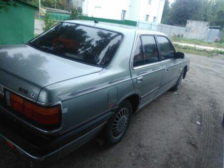 Серый Мазда 929, объемом двигателя 2.2 л и пробегом 300 тыс. км за 2305 $, фото 1 на Automoto.ua