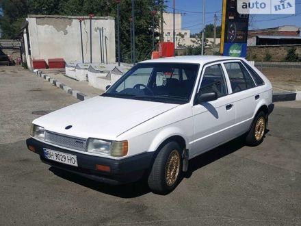 Белый Мазда Фамилия, объемом двигателя 1.3 л и пробегом 330 тыс. км за 1600 $, фото 1 на Automoto.ua