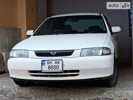 Белый Мазда Фамилия, объемом двигателя 1.6 л и пробегом 243 тыс. км за 2999 $, фото 1 на Automoto.ua