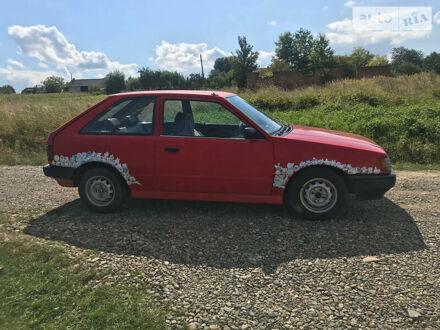Красный Мазда Фамилия, объемом двигателя 1.5 л и пробегом 312 тыс. км за 1000 $, фото 1 на Automoto.ua