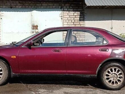 Красный Мазда Кседос 6, объемом двигателя 2 л и пробегом 230 тыс. км за 3500 $, фото 1 на Automoto.ua