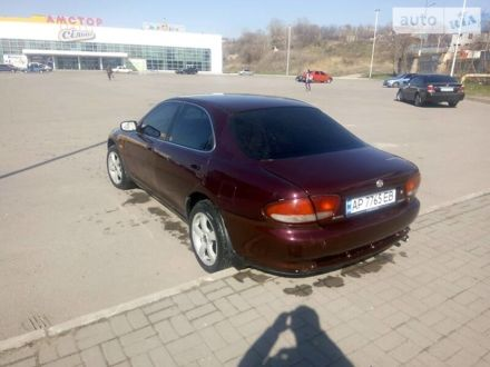 Красный Мазда Кседос 6, объемом двигателя 1.6 л и пробегом 380 тыс. км за 3000 $, фото 1 на Automoto.ua