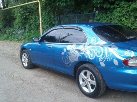 Синій Мазда Кседос 6, об'ємом двигуна 2 л та пробігом 320 тис. км за 3900 $, фото 1 на Automoto.ua