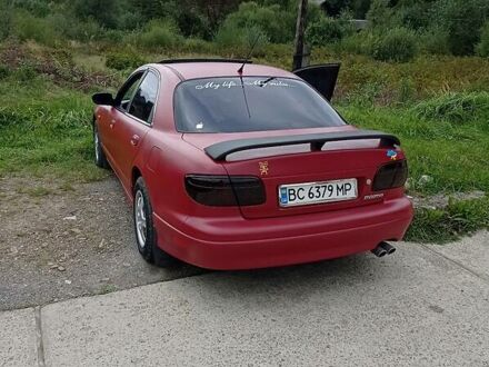 Червоний Мазда Кседос 9, об'ємом двигуна 2.3 л та пробігом 340 тис. км за 4900 $, фото 1 на Automoto.ua