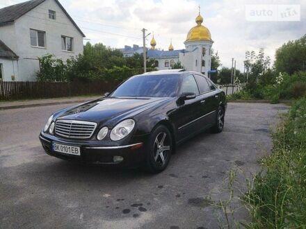 Черный Мерседес Е 500, объемом двигателя 5 л и пробегом 284 тыс. км за 13300 $, фото 1 на Automoto.ua