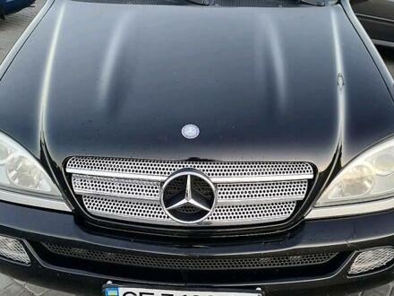 Черный Мерседес МЛ 270, объемом двигателя 2.7 л и пробегом 301 тыс. км за 7700 $, фото 1 на Automoto.ua
