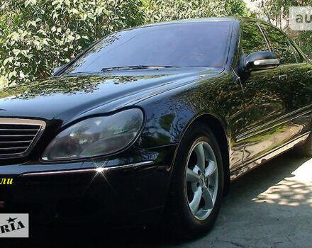 Черный Мерседес С 500, объемом двигателя 5 л и пробегом 317 тыс. км за 13500 $, фото 1 на Automoto.ua