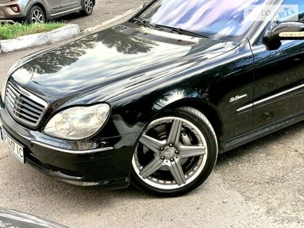 Черный Мерседес С 55 АМГ, объемом двигателя 5.4 л и пробегом 211 тыс. км за 8800 $, фото 1 на Automoto.ua