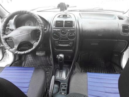 Серый Мицубиси Харизма, объемом двигателя 1.6 л и пробегом 250 тыс. км за 3550 $, фото 1 на Automoto.ua