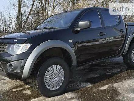 Чорний Міцубісі Л 200, об'ємом двигуна 2.5 л та пробігом 280 тис. км за 12500 $, фото 1 на Automoto.ua