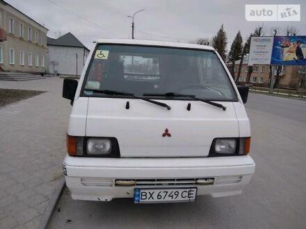 Белый Мицубиси Л 300 пасс., объемом двигателя 1.6 л и пробегом 300 тыс. км за 1800 $, фото 1 на Automoto.ua