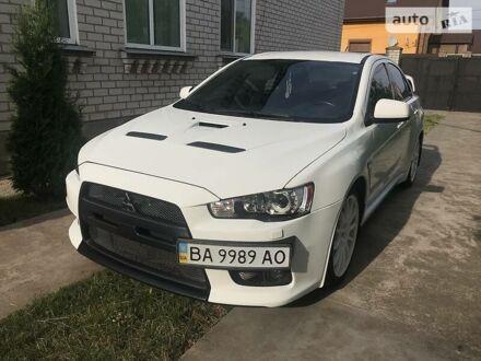 Білий Міцубісі Лансер Еволюшн, об'ємом двигуна 2 л та пробігом 103 тис. км за 15500 $, фото 1 на Automoto.ua