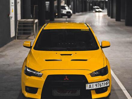 Жовтий Міцубісі Лансер Еволюшн, об'ємом двигуна 2 л та пробігом 160 тис. км за 23500 $, фото 1 на Automoto.ua