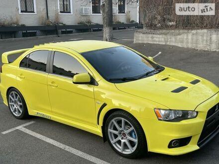 Жовтий Міцубісі Лансер Еволюшн, об'ємом двигуна 2 л та пробігом 70 тис. км за 15500 $, фото 1 на Automoto.ua