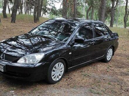 Черный Мицубиси Лансер, объемом двигателя 1.6 л и пробегом 189 тыс. км за 5700 $, фото 1 на Automoto.ua