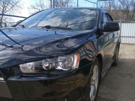 Черный Мицубиси Лансер, объемом двигателя 2 л и пробегом 120 тыс. км за 8400 $, фото 1 на Automoto.ua