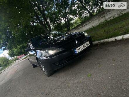 Черный Мицубиси Лансер, объемом двигателя 1.6 л и пробегом 199 тыс. км за 5999 $, фото 1 на Automoto.ua