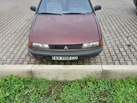Красный Мицубиси Лансер, объемом двигателя 1.3 л и пробегом 400 тыс. км за 1800 $, фото 1 на Automoto.ua