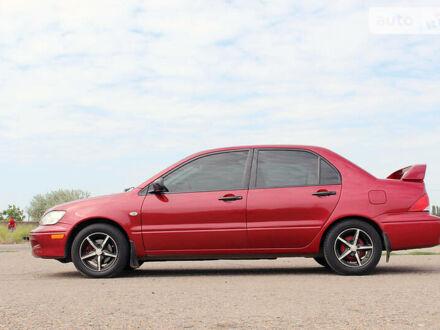 Красный Мицубиси Лансер, объемом двигателя 2 л и пробегом 180 тыс. км за 5300 $, фото 1 на Automoto.ua