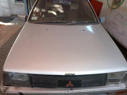 Серебряный Мицубиси Мираж, объемом двигателя 1.5 л и пробегом 310 тыс. км за 650 $, фото 1 на Automoto.ua