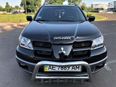 Черный Мицубиси Аутлендер, объемом двигателя 2.4 л и пробегом 72 тыс. км за 10800 $, фото 1 на Automoto.ua