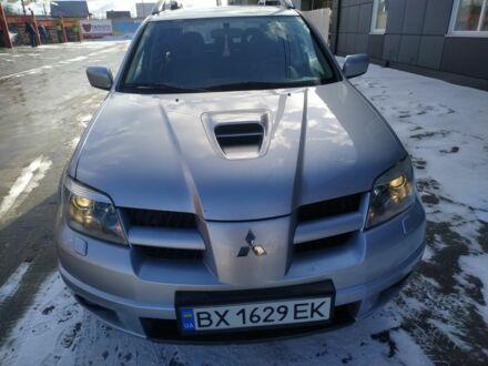 Серебряный Мицубиси Аутлендер, объемом двигателя 2 л и пробегом 200 тыс. км за 7800 $, фото 1 на Automoto.ua