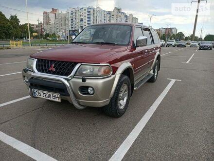 Красный Мицубиси Паджеро Спорт, объемом двигателя 3 л и пробегом 216 тыс. км за 8400 $, фото 1 на Automoto.ua