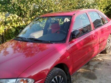 Красный Мицубиси Протон, объемом двигателя 1.46 л и пробегом 270 тыс. км за 3500 $, фото 1 на Automoto.ua