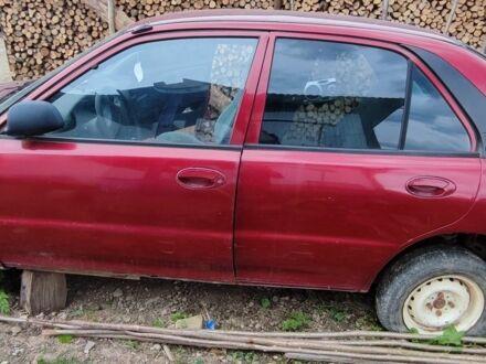 Красный Мицубиси Протон, объемом двигателя 1.5 л и пробегом 200 тыс. км за 800 $, фото 1 на Automoto.ua