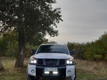 Серый Ниссан Титан, объемом двигателя 5.6 л и пробегом 193 тыс. км за 16000 $, фото 1 на Automoto.ua