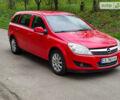 Красный Опель Астра Н, объемом двигателя 1.7 л и пробегом 240 тыс. км за 5745 $, фото 1 на Automoto.ua