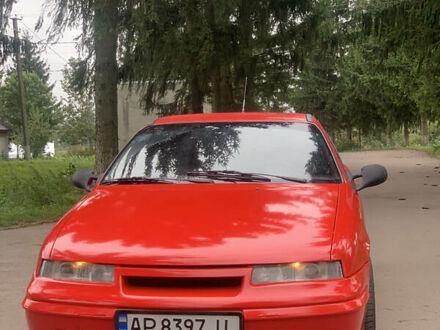 Червоний Опель Калібра, об'ємом двигуна 2 л та пробігом 300 тис. км за 2555 $, фото 1 на Automoto.ua