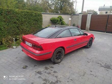 Красный Опель Калибра, объемом двигателя 2 л и пробегом 333 тыс. км за 4000 $, фото 1 на Automoto.ua