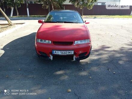 Красный Опель Калибра, объемом двигателя 2 л и пробегом 245 тыс. км за 2400 $, фото 1 на Automoto.ua