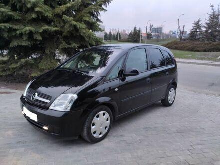Черный Опель Мерива, объемом двигателя 1.6 л и пробегом 119 тыс. км за 4200 $, фото 1 на Automoto.ua