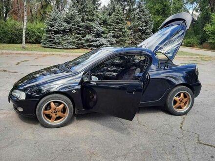 Оливковий Опель Тігра, об'ємом двигуна 1.4 л та пробігом 200 тис. км за 3800 $, фото 1 на Automoto.ua