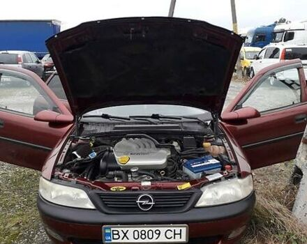Красный Опель Вектра Б, объемом двигателя 1.6 л и пробегом 337 тыс. км за 3150 $, фото 1 на Automoto.ua