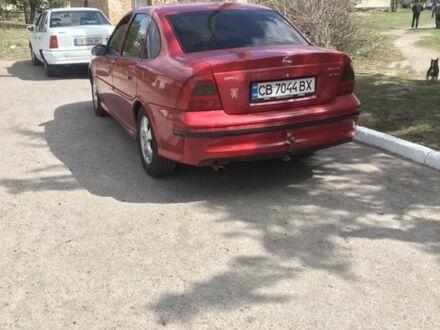 Красный Опель Вектра, объемом двигателя 1.6 л и пробегом 300 тыс. км за 3900 $, фото 1 на Automoto.ua