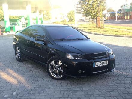 Черный Опель Astra Coupe Bertone, объемом двигателя 2 л и пробегом 175 тыс. км за 6000 $, фото 1 на Automoto.ua